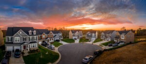 First Home - At the end of a residential road, a circular court with beautiful homes, with clean yards and lawns, at dusk
