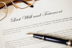 Pen on top of Last Will and Testament document.